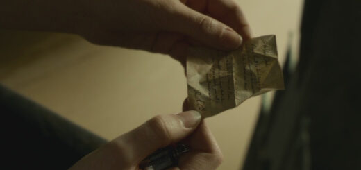 Hermione holding the note R.A.B. left in the fake locket