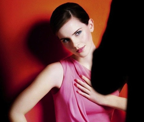 Emma Watson in a pink dress posing for a photographer