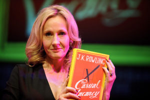 "JK Rowling proudly holds copy of ""The Casual Vacancy"""