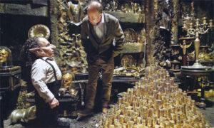 Warwick Davis as Griphook on set with David Yates