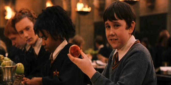 """Neville Longbottom is shown holding his Remembrall in """"Harry Potter and the Sorcerer's Stone""""."""