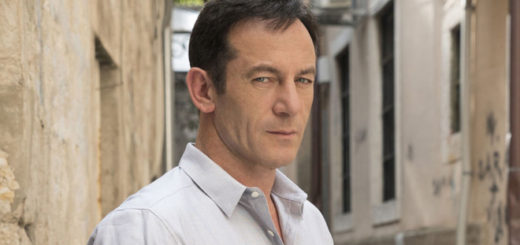 Jason Isaacs looks smoulderingly into the camera.