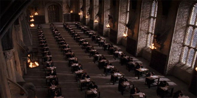 Hogwarts students taking OWL exams in the great hall