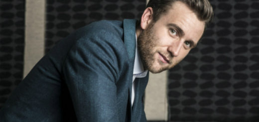 Matthew Lewis is pictured super handsomely in an elegant suit and tie.