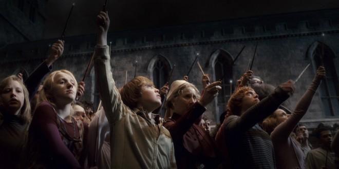 Hogwarts raise their wands after Dumbledore's death