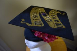 Additional decorations like flowers and ribbons for the diy Potter graduation cap