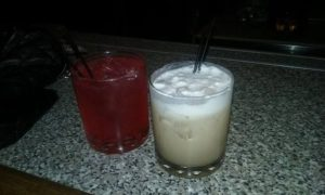 Photo of Amortentia martini and Butterbeer in bar glasses.