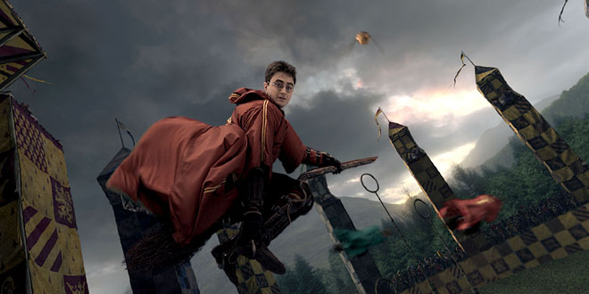 Harry on broom during Quidditch game, looking at camera