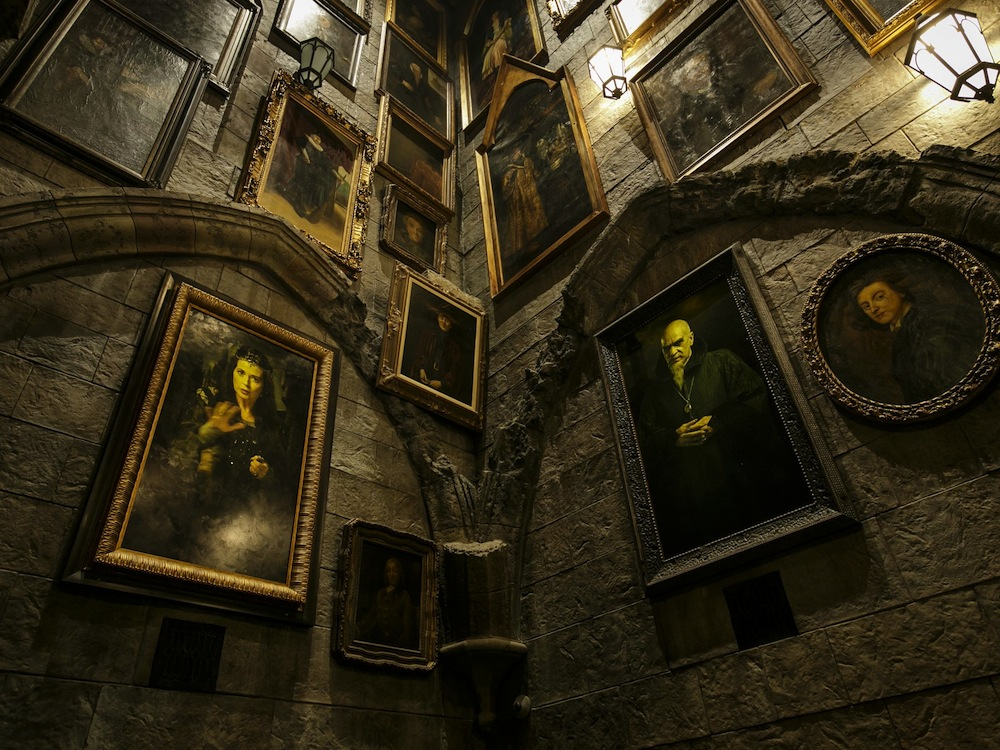 A wall filled with talking portraits within Wizarding World of Harry Potter - Universal Studios Hollywood