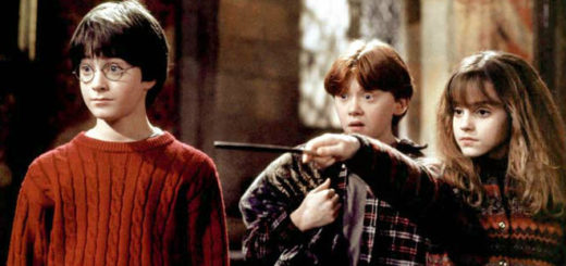 Harry and Ron look on, shocked, as Hermione grimly points her wand at someone off-screen