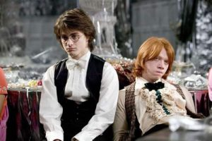 Harry and Ron sitting down at the Yule Ball