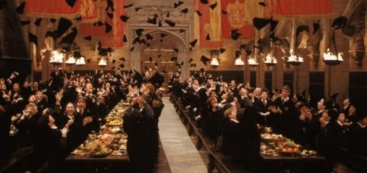 Harry Potter and friends are shown cheering and clapping in the Great Hall at the end-of-year feast.