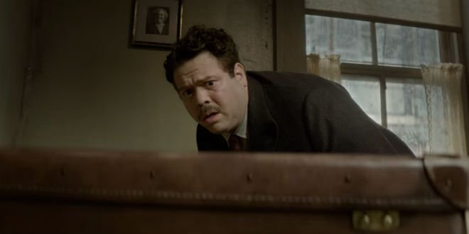 Jacob looking worried with Newt's suitcase.