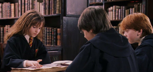 Harry, Ron, and Hermione reading in the library
