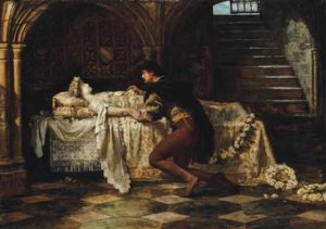 Romeo kneeling before Juliet who is laying on a bed