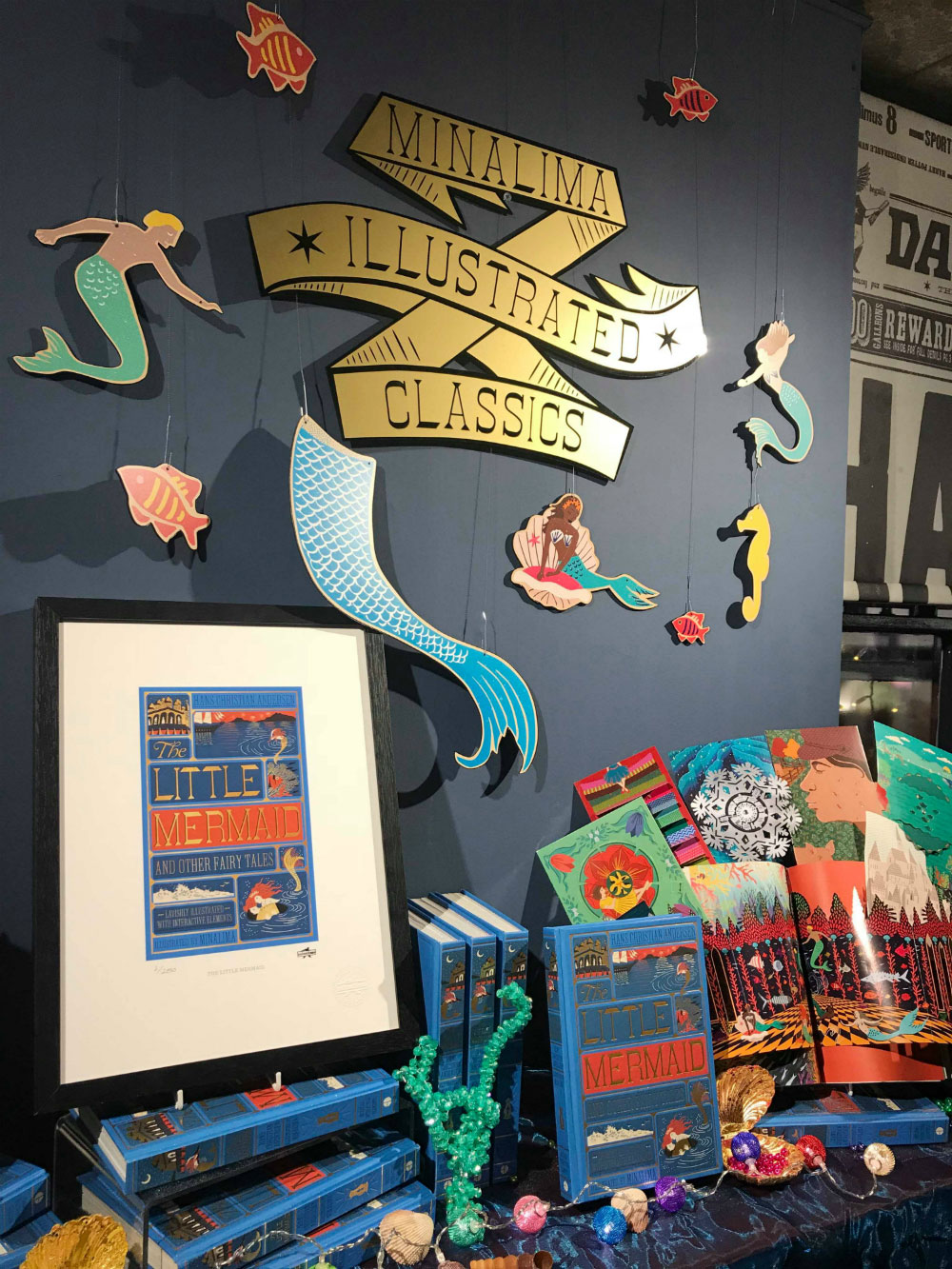 The exhibition had a special mermaid-themed display for the night, which was decorated with pages from the book, shells, and beads.