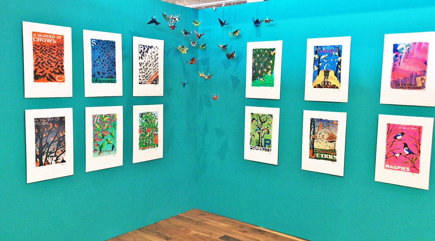 Origami birds hang from the Collective Nouns display.