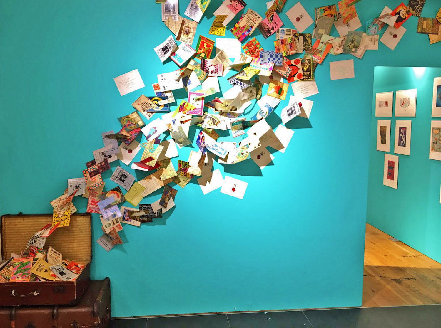 A fun installation covers one wall. It's a suitcase with wizarding world pamphlets flying out of it.