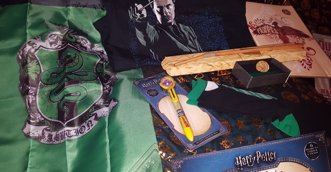 Banner, recipes, coloring pages, pen, House socks, Ron's broken wand, Fawkes print, House wax stamp, Head Boy and Girl pins, Remus Lupin T-shirt