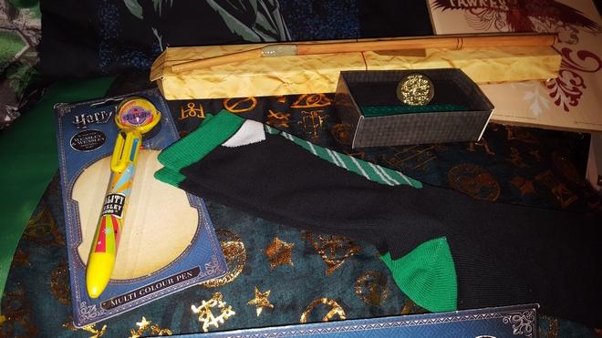 """Harry Potter"" pen, House socks, Ron's broken wand, Fawkes print"