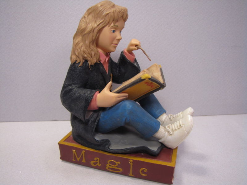Merchandise like this Hermione bookend was based on the illustrations from the US editions.