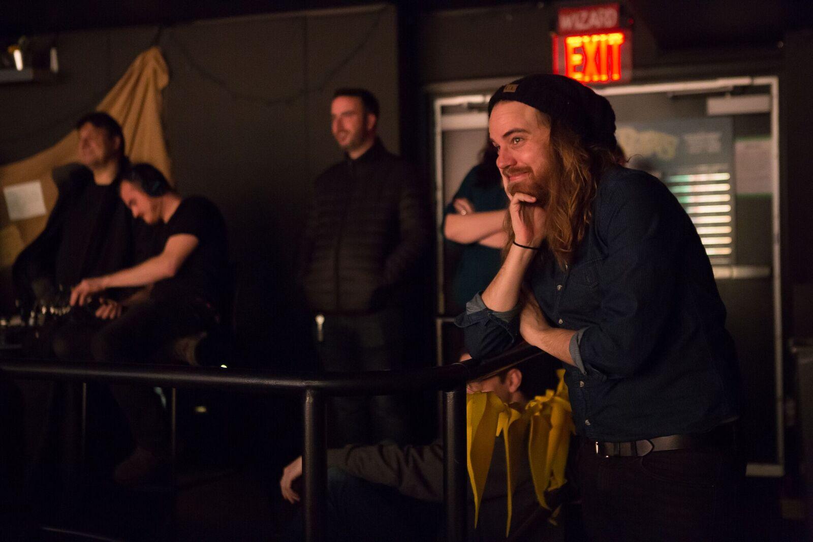"""Playwright Matt Cox watches a """"Puffs: Filmed Live"""" preview."""