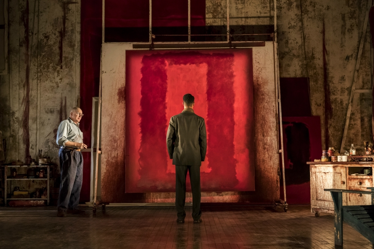 """""""Red"""" features set and costume design by Christopher Oram, lighting by Neil Austin, and sound design by Adam Cork."""