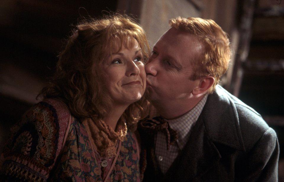 Arthur kissing Molly.