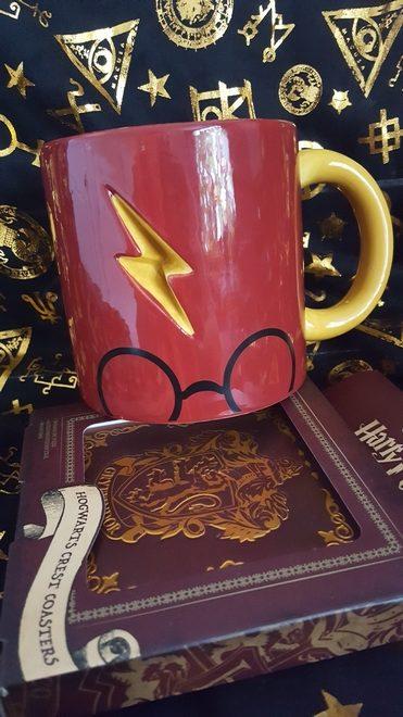 "Box of ""Harry Potter"" Hogwarts crest coasters and the ""Harry Potter"" mug showing Harry's glasses and lightning bolt scar"