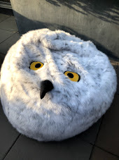"A ""Harry Potter"" bean bag made to look like a snowy owl, including yellow eyes and a beak"
