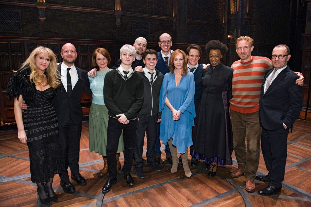 """The New York City opening cast of """"Harry Potter and the Cursed Child"""" poses with J.K. Rowling, producers Colin Callender and Sonia Friedman, writer Jack Thorne, and director John Tiffany."""