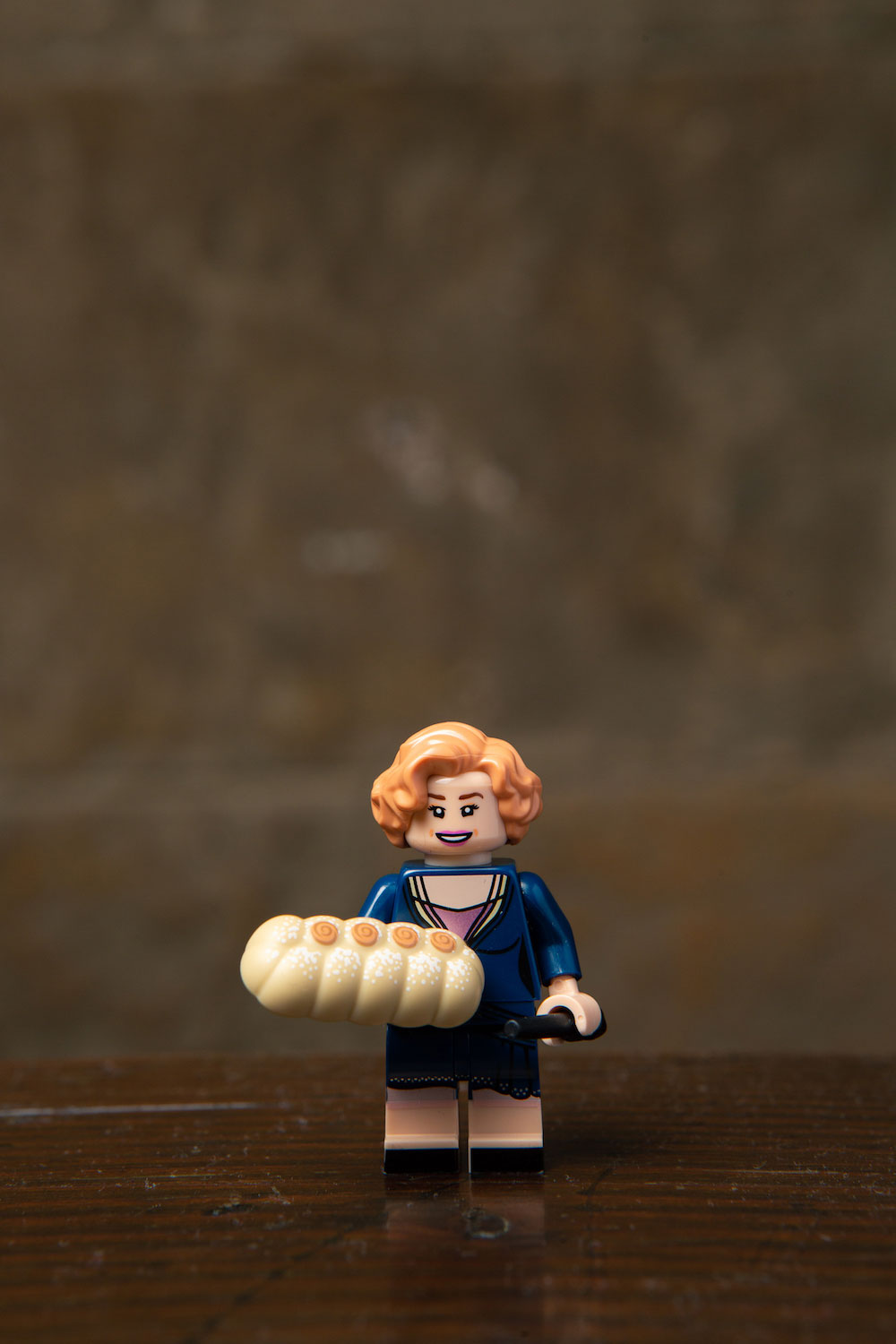 Queenie's LEGO minifigure includes a LEGO strudel… we wish we could eat it. (LEGO minifigures and all their parts not advised for children under 5.)