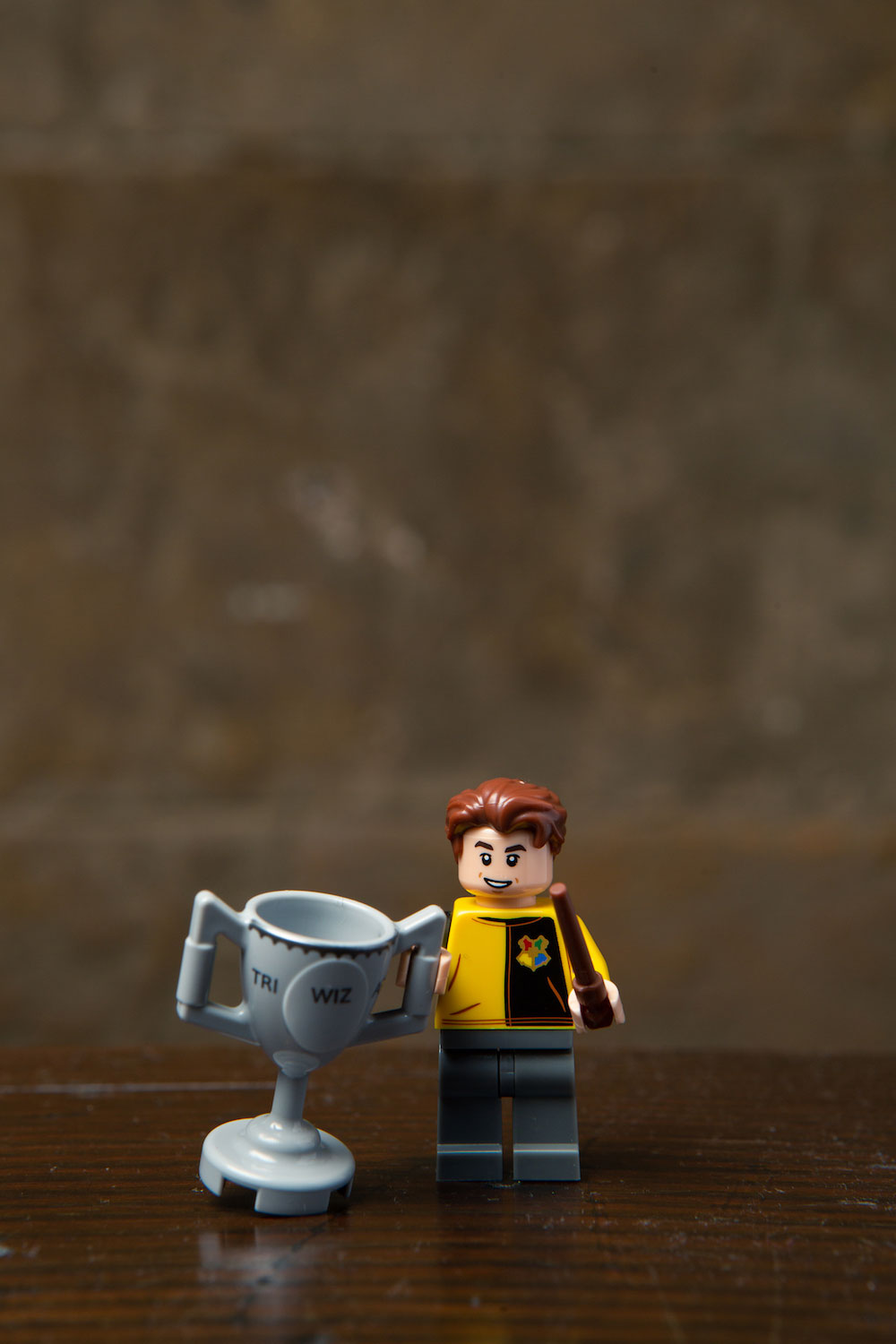 Hufflepuffs represent! Cedric's LEGO minifigure drags his trophy along in his Triwizard Tournament uniform.