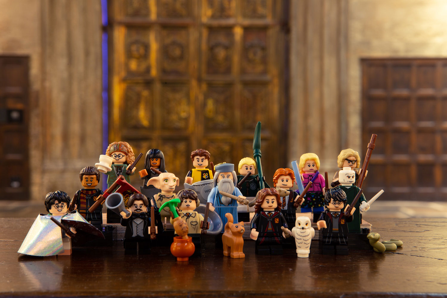 "All the ""Harry Potter"" LEGO minifigures pose in front of the Great Hall doors at the Studio Tour."