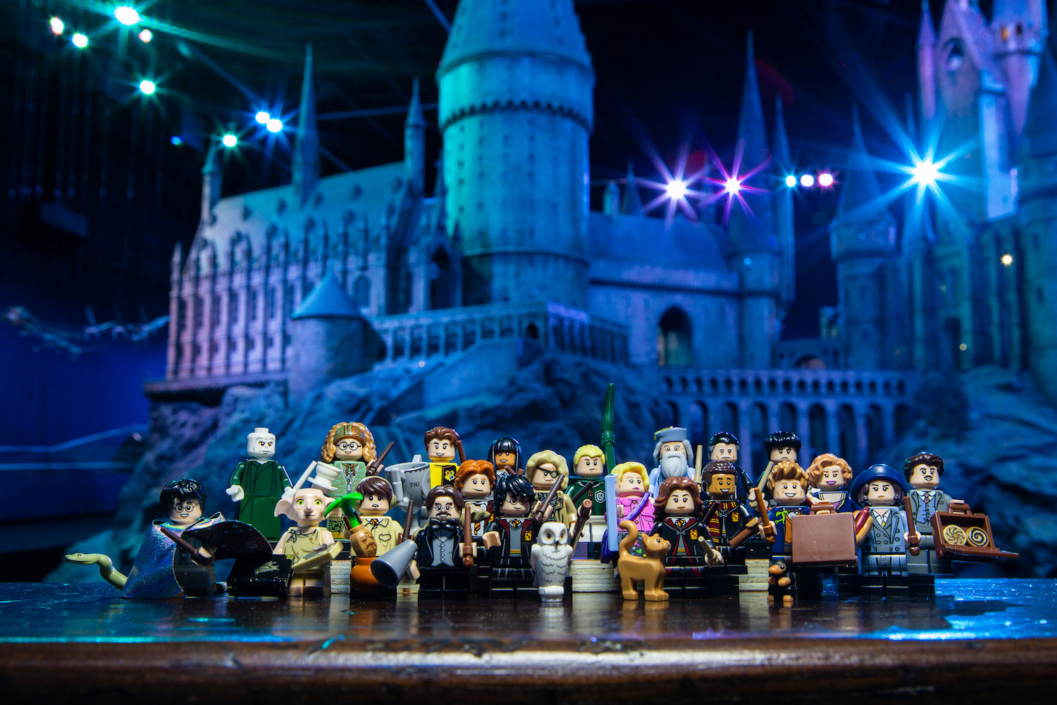 "Worlds collide! The complete set of ""Fantastic Beasts"" and ""Harry Potter"" minifigures took a field trip together to the Studio Tour."