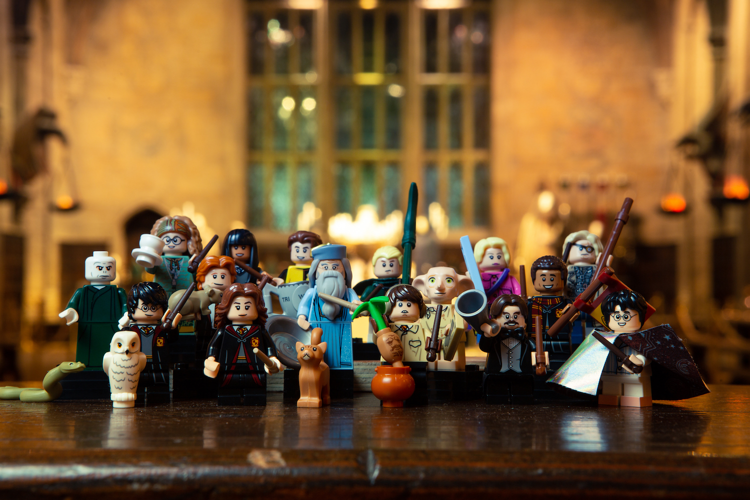 "Iconic ""Harry Potter"" characters from the new LEGO minifigures series are featured together with a Great Hall backdrop."
