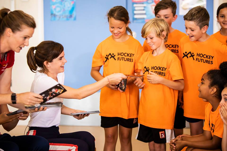 Emma Watson and the England Hockey players pass out tickets to the Vitality Hockey Women's World Cup.