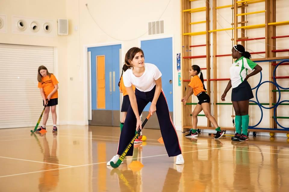 Emma Watson demonstrates her field hockey skills.