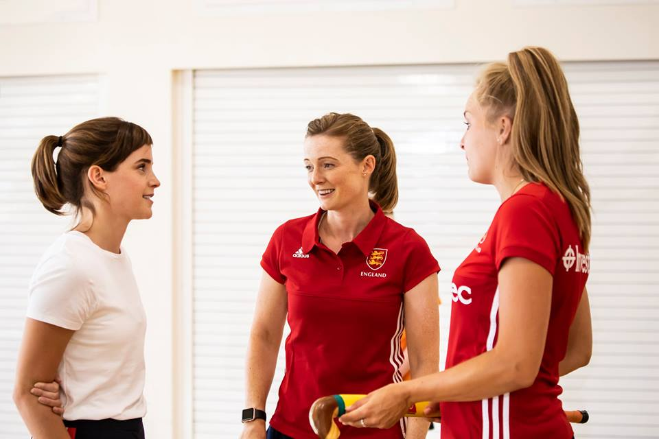 Emma Watson talks to England Hockey players Helen Richardson-Walsh and Emily Defroand.