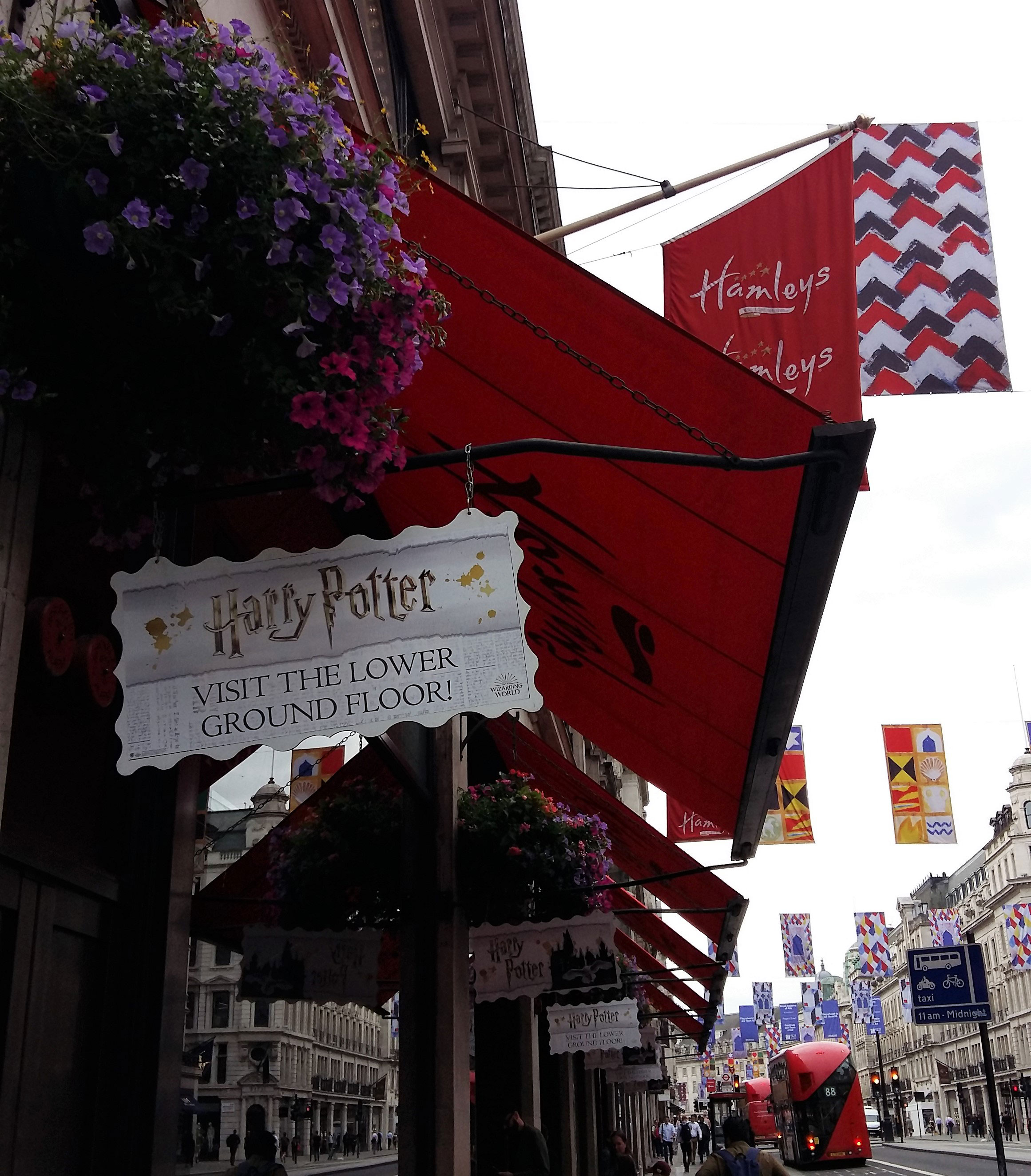 "Hamleys storefront on Regent Street with sign advertising the ""Harry Potter"" floor"