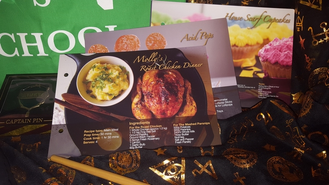 Geek Gear July 2018: Wizarding world recipe cards featuring Molly's roast chicken dinner, acid pops, and House scarf cupcakes