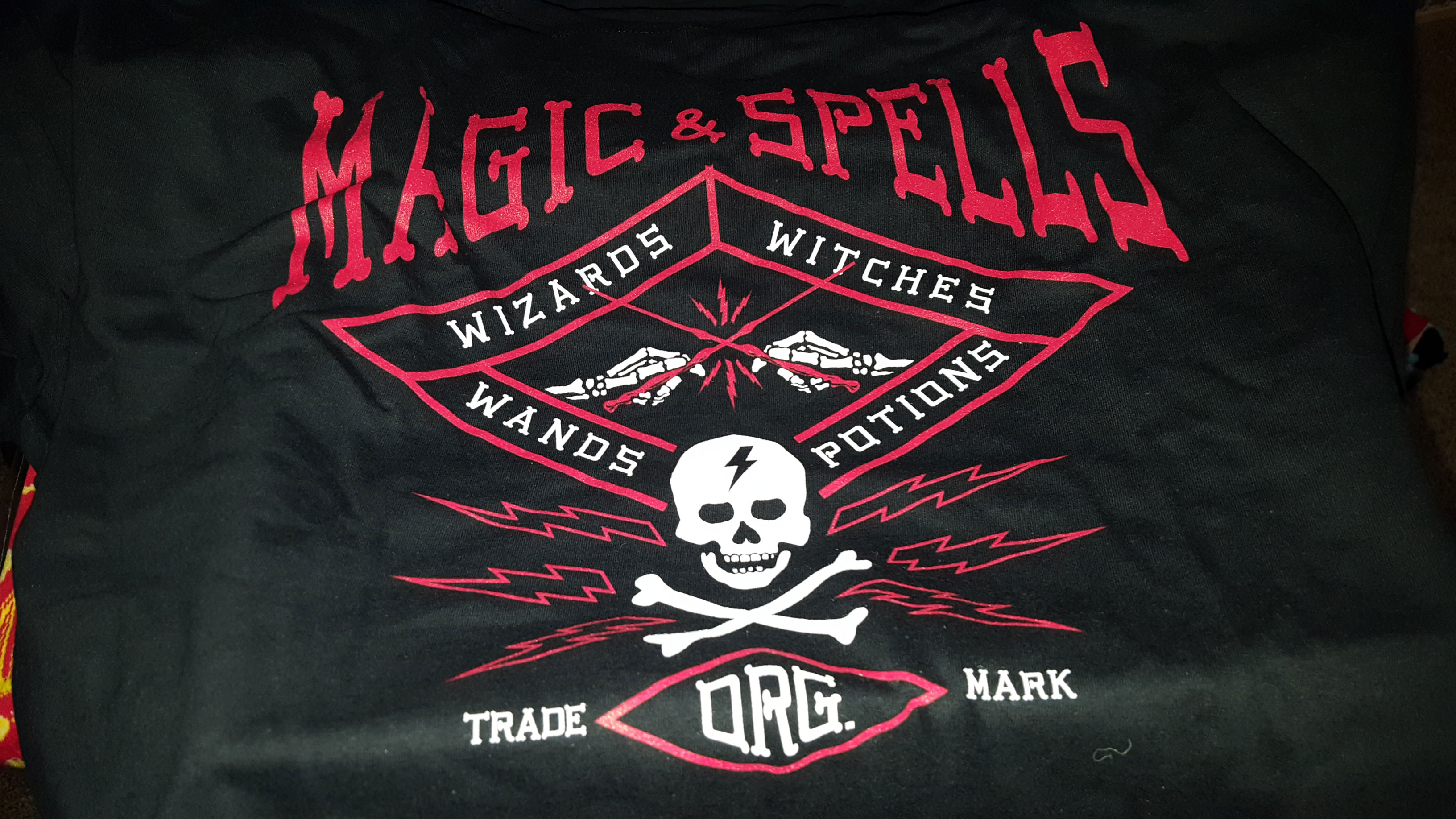 """""""Magic & Spells"""" T-shirt, showing dueling wands held by skeleton hands"""