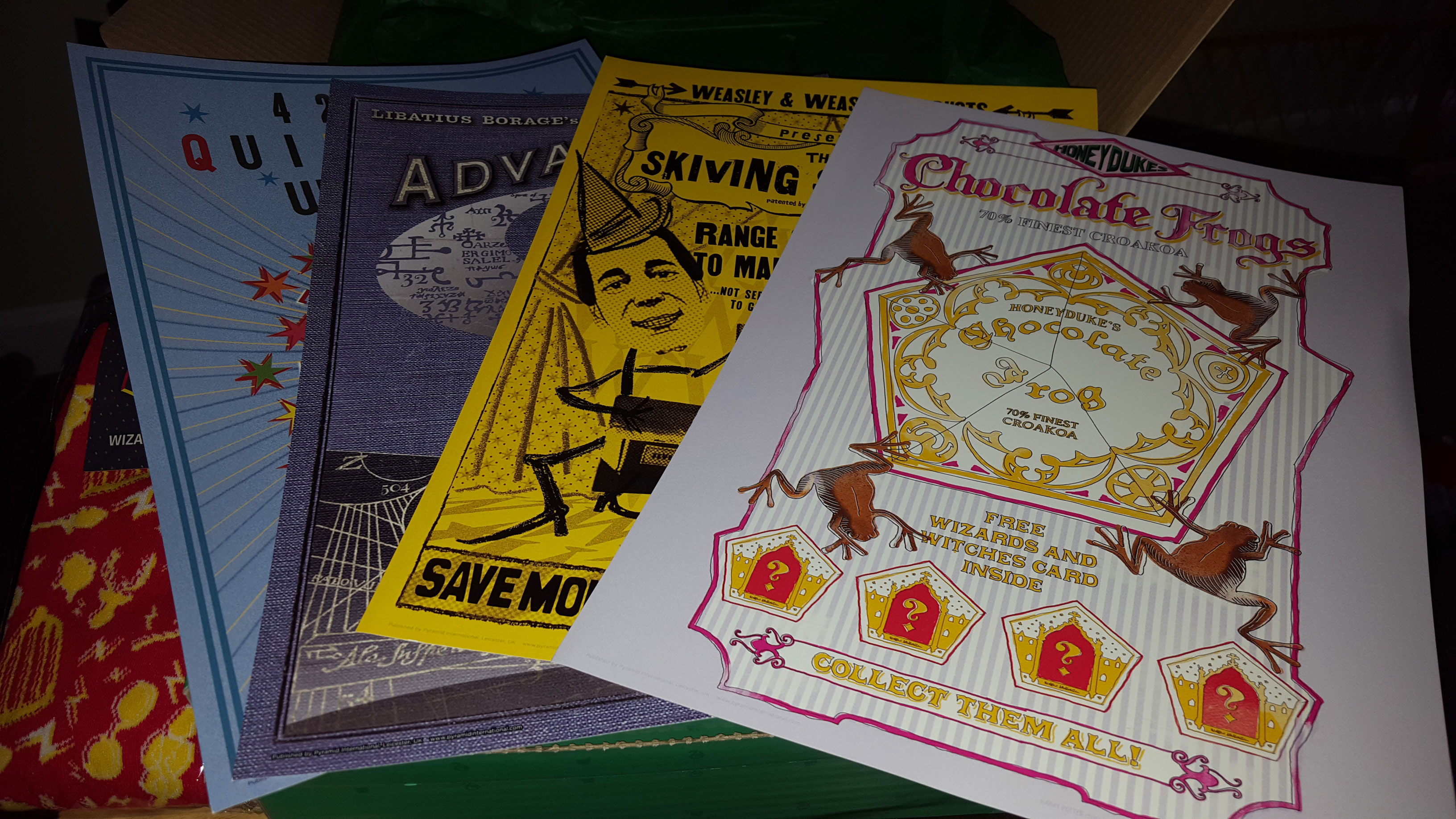 """MinaLima prints featuring Quidditch World Cup, """"Advanced Potion-Making"""", Skiving Snackboxes, and Honeydukes Chocolate Frogs art"""