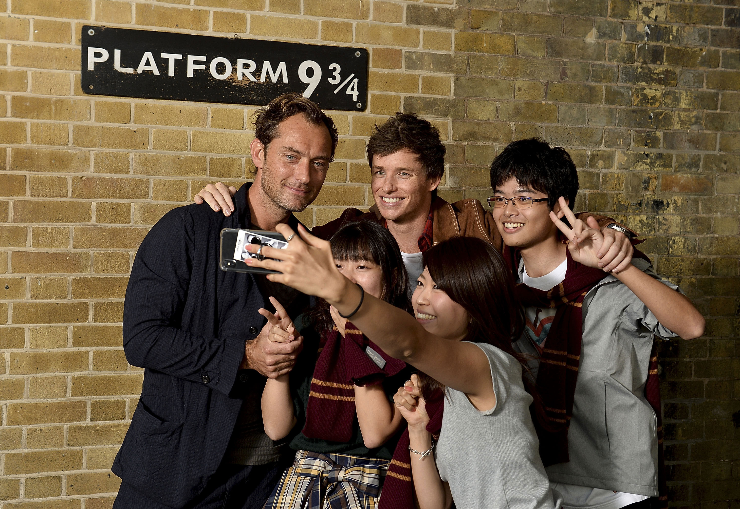 Redmayne is off the hook for this selfie as a group of Gryffindors snaps a photo.