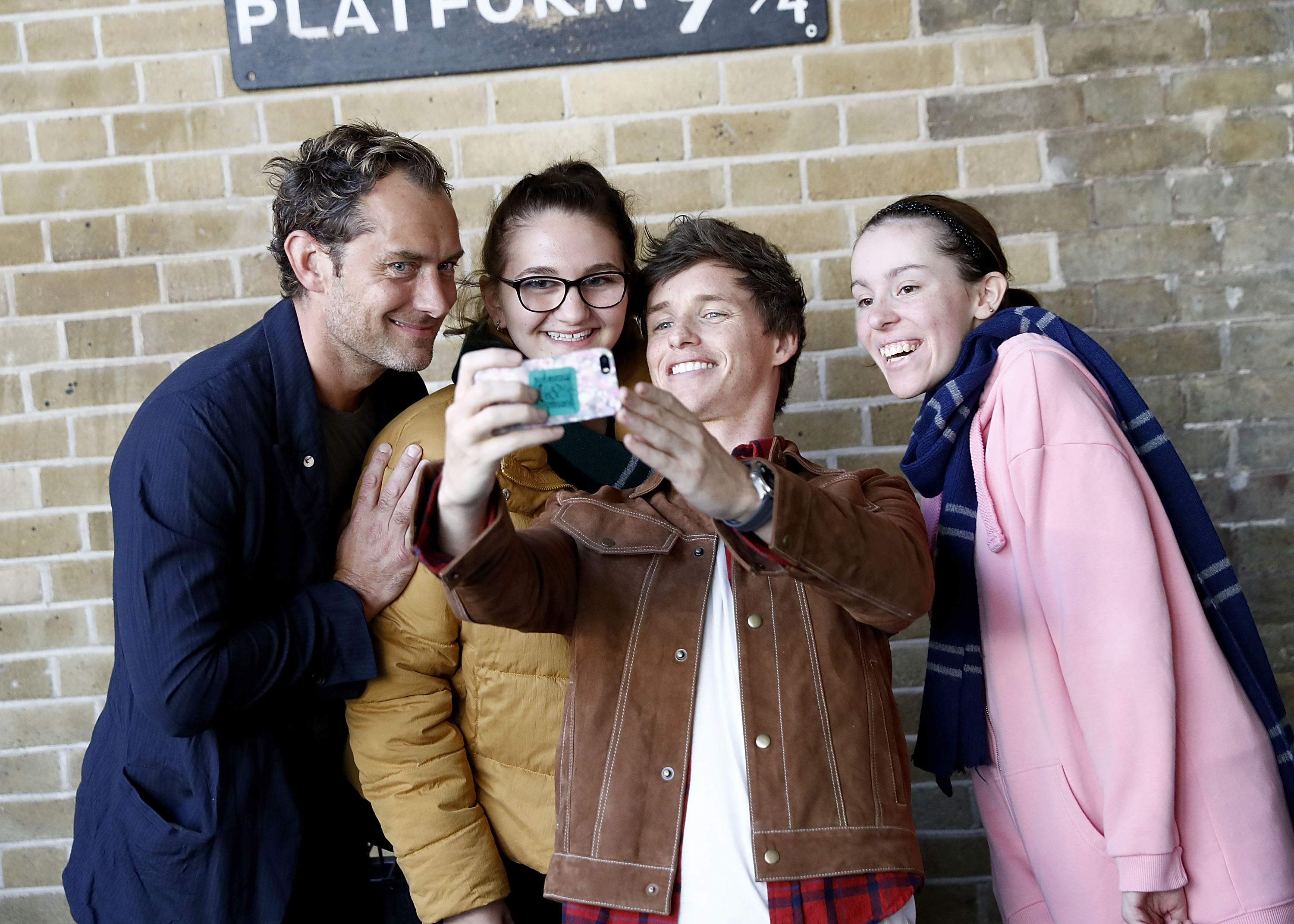 Redmayne snaps a selfie of Law and two select fans.