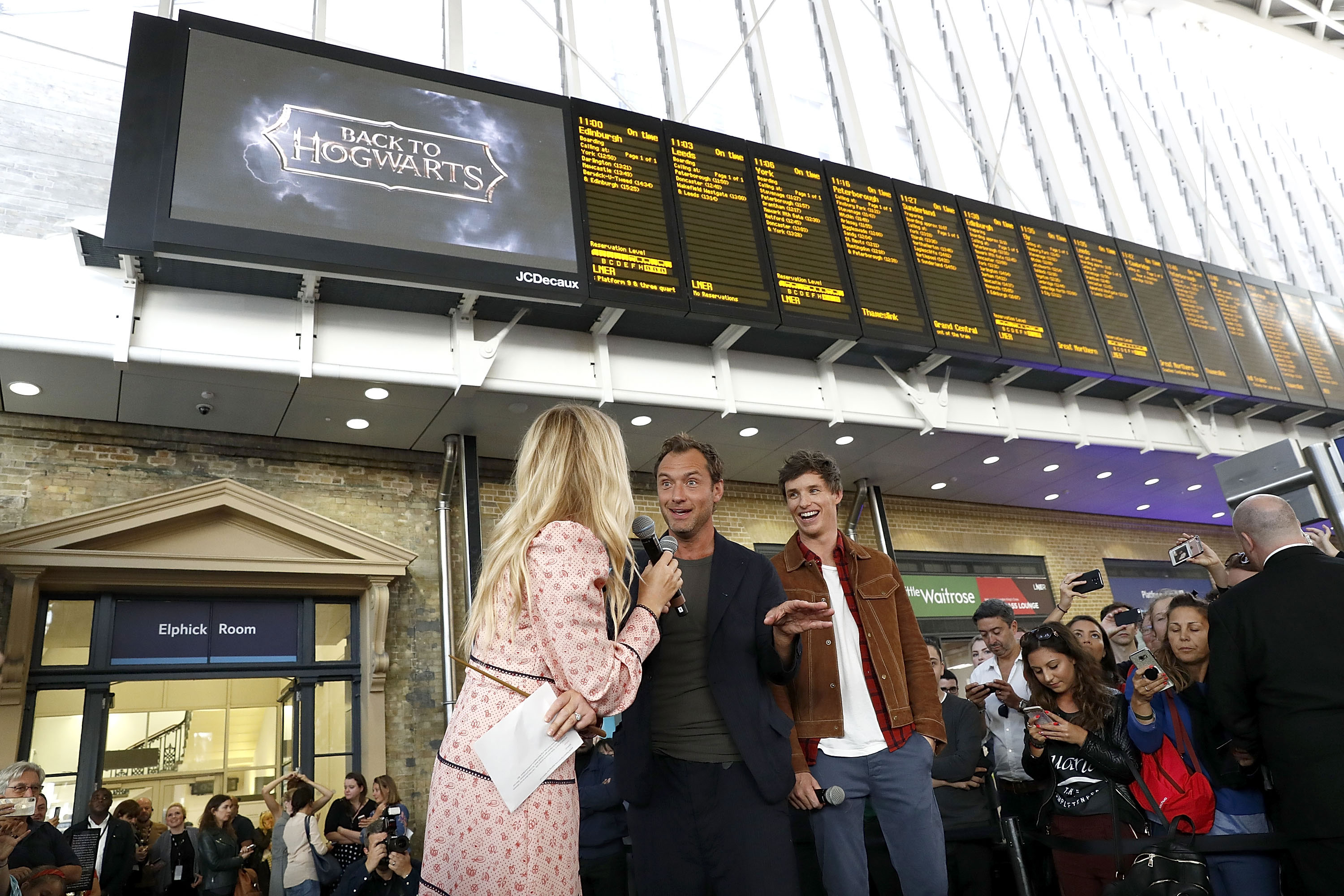 Law and Redmayne answer interview questions at King's Cross Station's Back to Hogwarts celebration.