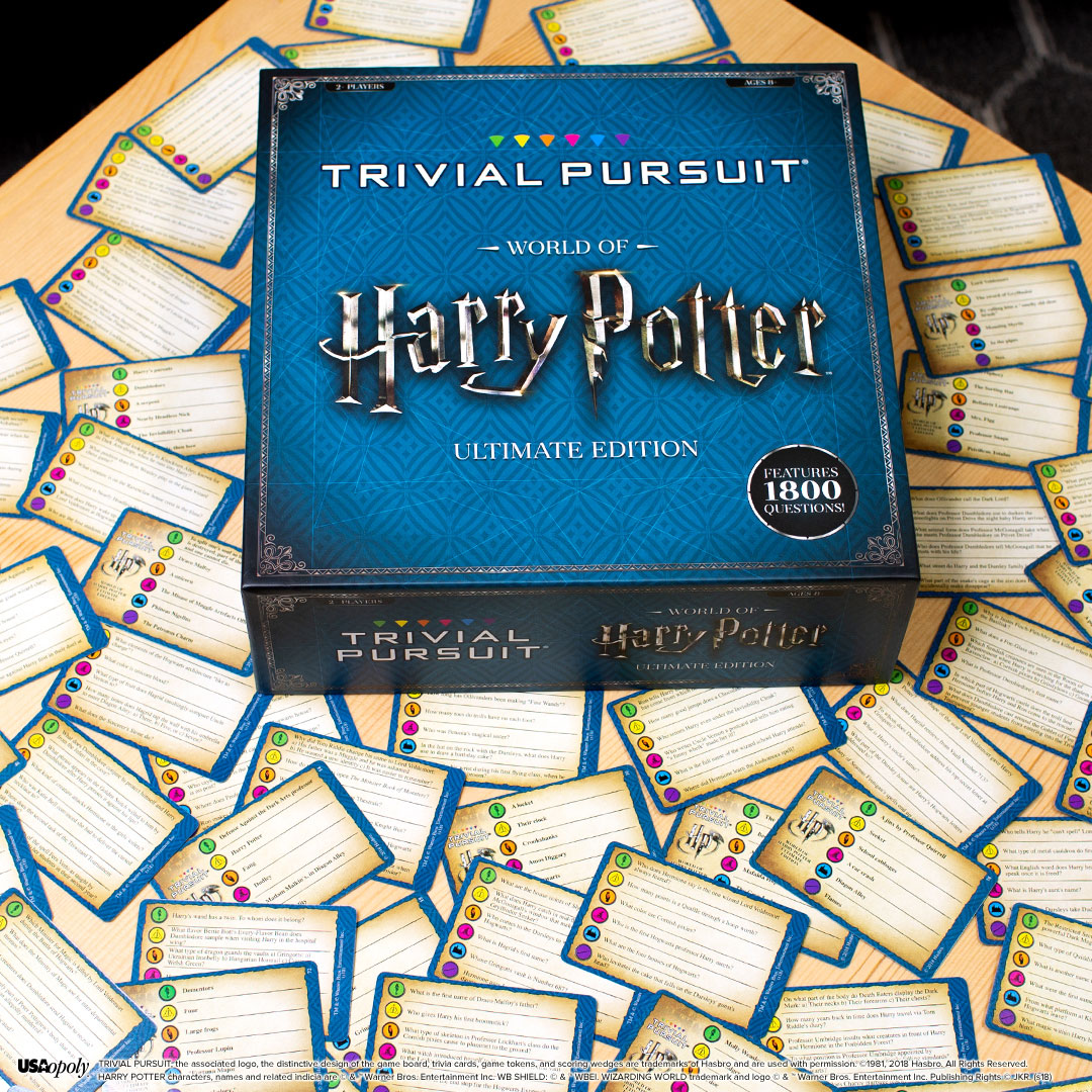 Trivial Pursuit: World of Harry Potter Ultimate Edition box with trivia cards spread out underneath