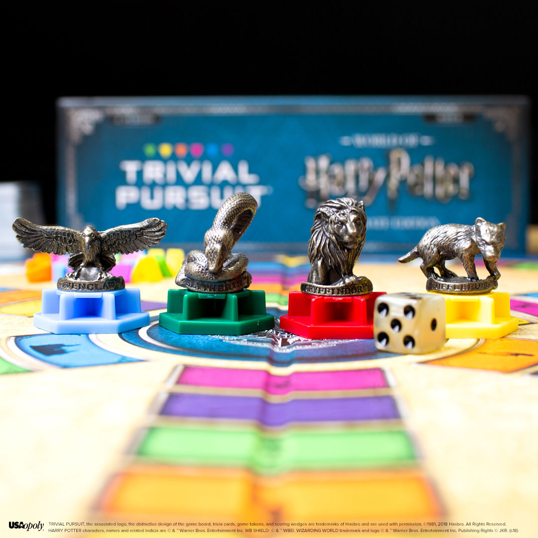 Trivial Pursuit: World of Harry Potter Ultimate Edition game pieces featuring each House mascot and die