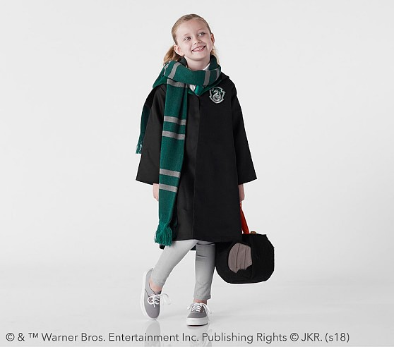 The adorable Slytherin costume comes with the House cloak, tie, and scarf.