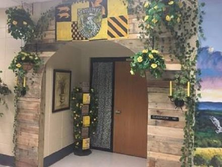 The Hufflepuff classroom entrance is covered in plants, greenery, and natural wood.